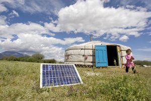 A family in Tarialan, Uvs Province, Mongolia, uses a solar panel to generate power for their ger, a traditional Mongolian tent. 28/Jul/2009. Tarialan, Mongolia. UN Photo/Eskinder Debebe. www.un.org/av/photo/