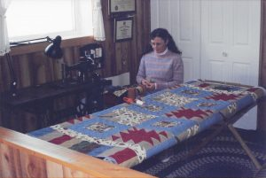 Johanna spinning yarn in her shop